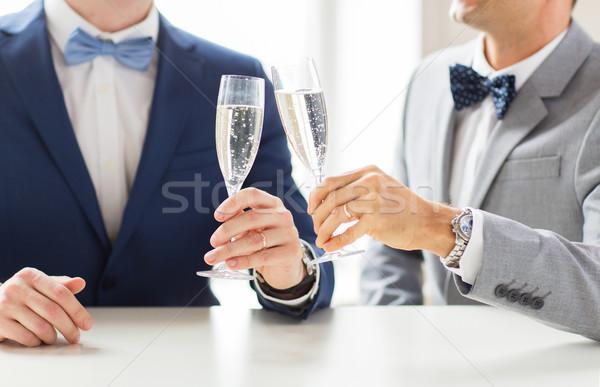 Erkek eşcinsel çift şampanya gözlük Stok fotoğraf © dolgachov