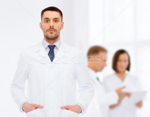 male doctor in white coat Stock photo © dolgachov