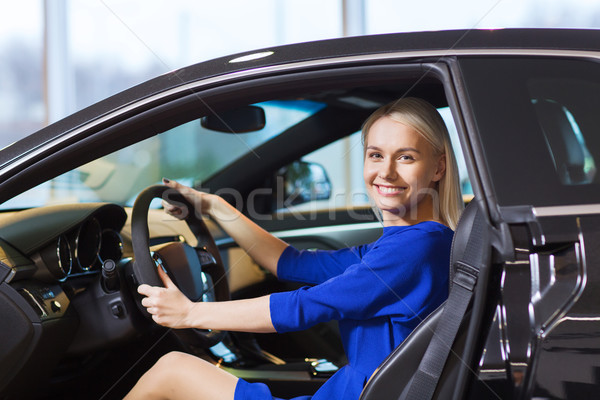 happy woman inside car in auto show or salon Stock photo © dolgachov
