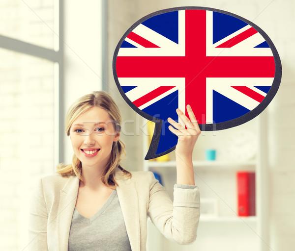 Stok fotoğraf: Gülümseyen · kadın · metin · kabarcık · İngiliz · bayrağı · eğitim · dil