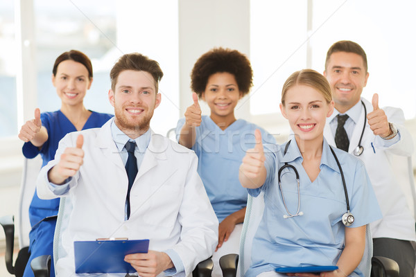 group of happy doctors on seminar at hospital Stock photo © dolgachov