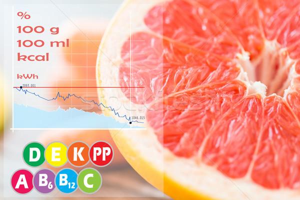 close up of fresh juicy grapefruit slice on table Stock photo © dolgachov