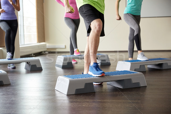 group of people flexing legs on step platforms Stock photo © dolgachov