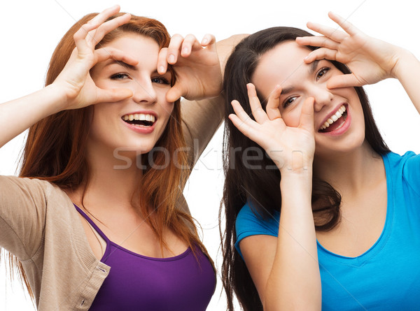 two young teenagers making faces Stock photo © dolgachov