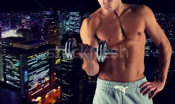 Jonge man biceps sport bodybuilding Stockfoto © dolgachov