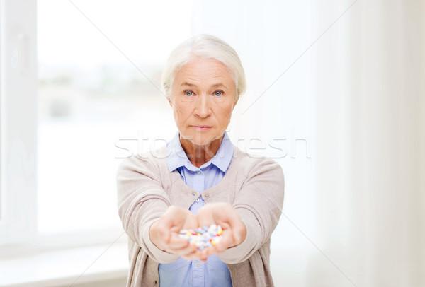 senior woman with medicine at home Stock photo © dolgachov