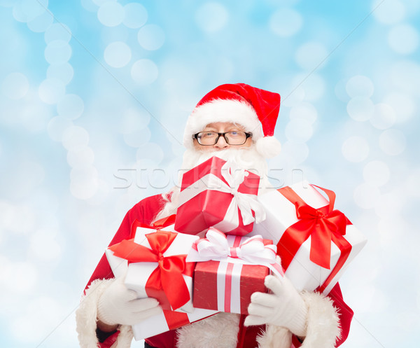 man in costume of santa claus with gift boxes Stock photo © dolgachov