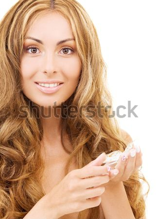 lovely woman with ice crystals Stock photo © dolgachov