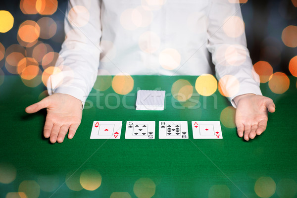 holdem dealer with playing cards over lights Stock photo © dolgachov