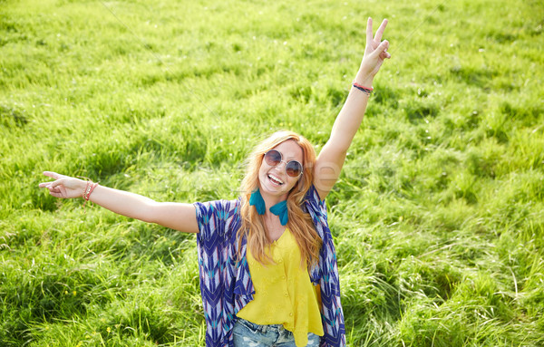 smiling young hippie woman dancing on green field Stock photo © dolgachov