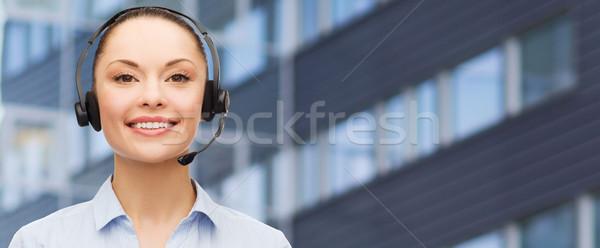 helpline operator in headset over business center Stock photo © dolgachov