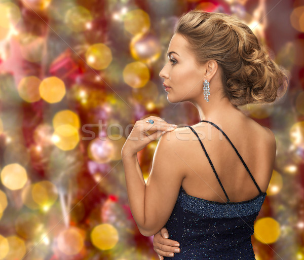 beautiful woman with diamond earring over lights Stock photo © dolgachov
