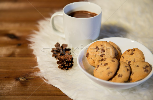 cups of hot chocolate with cookies on fur rug Stock photo © dolgachov