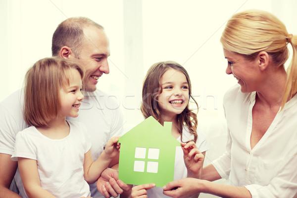 Mosolyog szülők kettő kislányok új otthon család Stock fotó © dolgachov