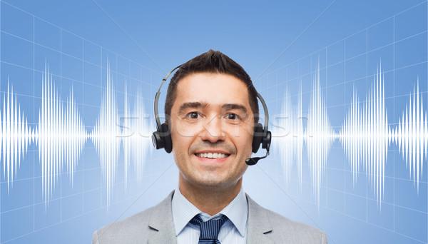 businessman in headset over sound wave or diagram Stock photo © dolgachov