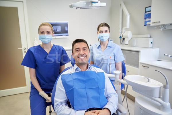 Сток-фото: счастливым · женщины · Стоматологи · человека · пациент · клинике