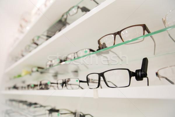 close up of eyeglasses at optician Stock photo © dolgachov