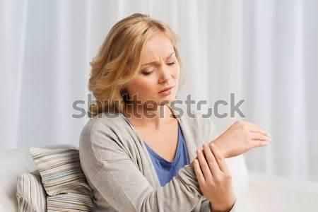 Malheureux femme souffrance douleur main maison Photo stock © dolgachov