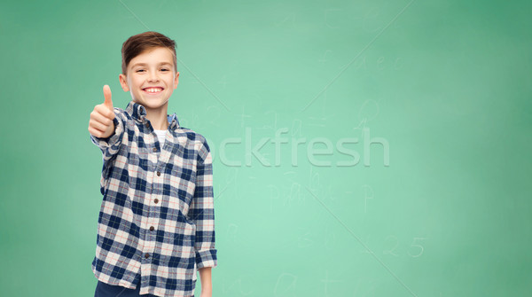 smiling boy in checkered shirt showing thumbs up Stock photo © dolgachov