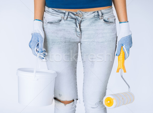 woman with roller and paint pot Stock photo © dolgachov