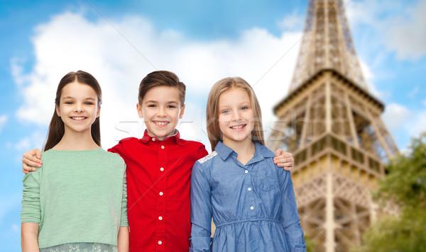 Vidám fiú lányok ölel Eiffel-torony gyermekkor utazás Stock fotó © dolgachov