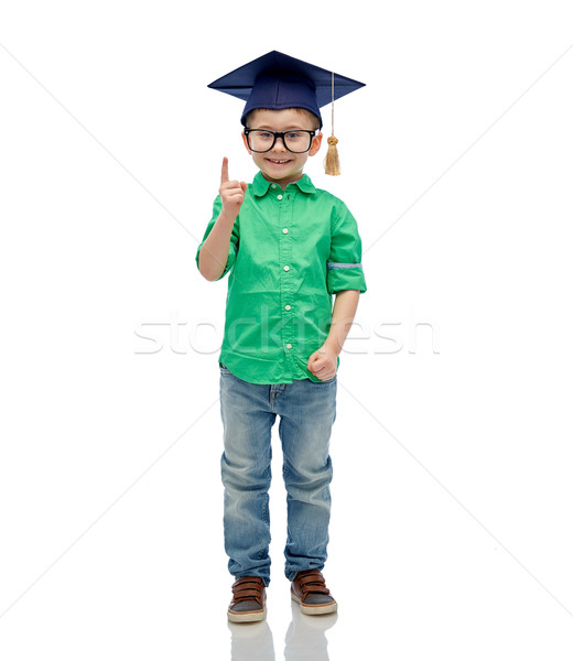 happy boy in bachelor hat and eyeglasses Stock photo © dolgachov