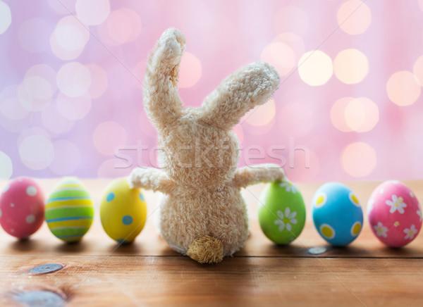 Közelkép színes húsvéti tojások nyuszi húsvét ünnepek Stock fotó © dolgachov