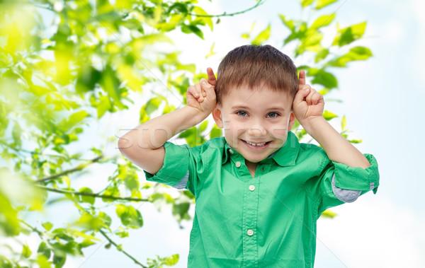 Boldog kicsi fiú szórakozás készít agancs Stock fotó © dolgachov