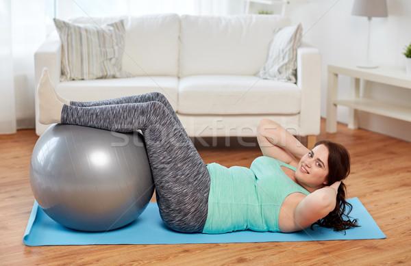 Plus size kobieta fitness piłka sportu Zdjęcia stock © dolgachov