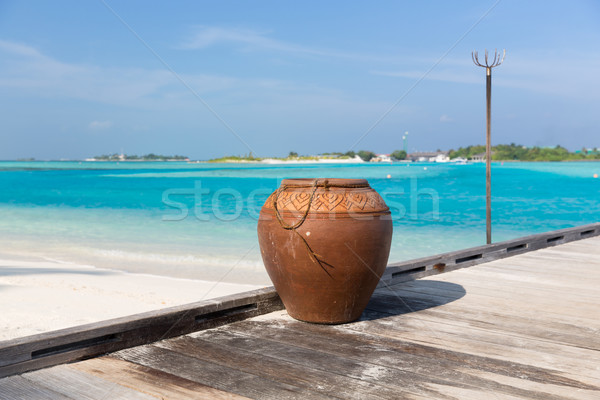 maldives island beach with vase on wood flooring Stock photo © dolgachov