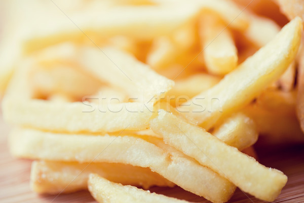 Stock photo: close up of french fries on table
