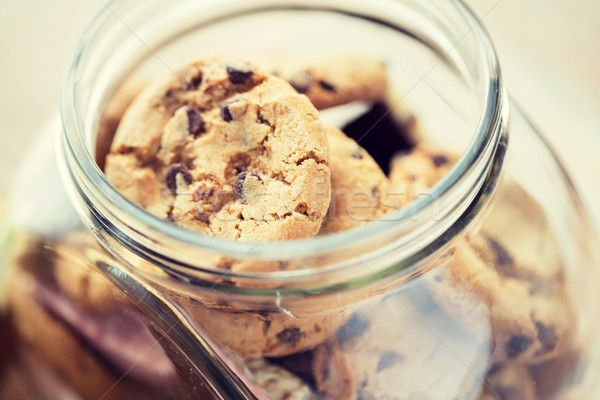 close up of chocolate oatmeal cookies in glass jar Stock photo © dolgachov