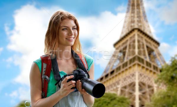Donna zaino fotocamera Torre Eiffel viaggio turismo Foto d'archivio © dolgachov