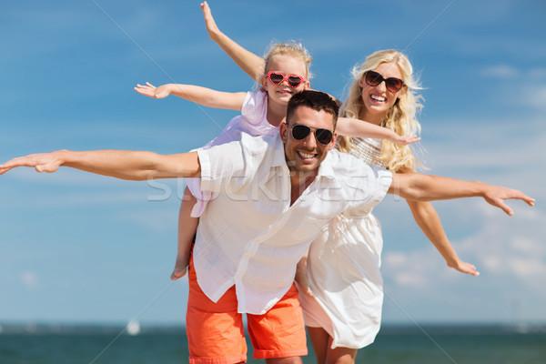幸せな家族 夏 ビーチ 家族 休暇 ストックフォト © dolgachov