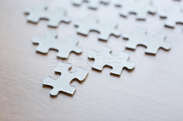 Közelkép kirakó darabok fából készült felület üzlet kapcsolat Stock fotó © dolgachov