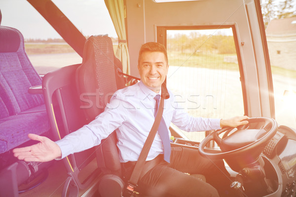 happy driver inviting on board of intercity bus Stock photo © dolgachov