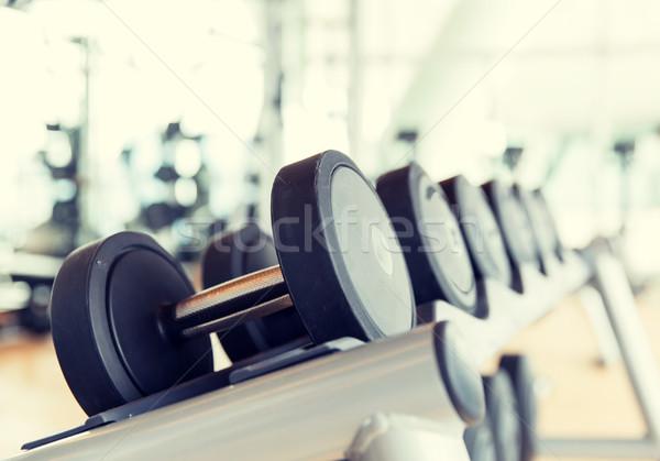close up of dumbbells in gym Stock photo © dolgachov