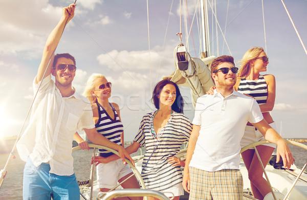 Sonriendo amigos vela yate vacaciones viaje Foto stock © dolgachov
