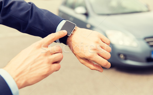 close up of male hands with wristwatch and car Stock photo © dolgachov