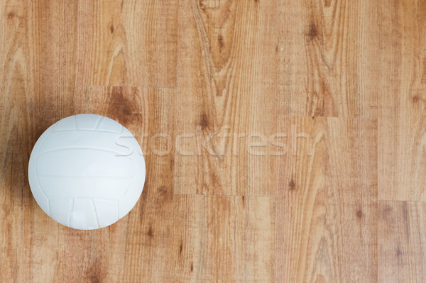 close up of volleyball ball on wooden floor Stock photo © dolgachov