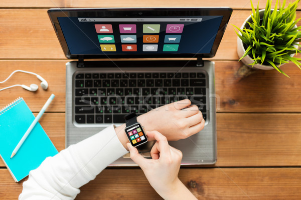 close up of woman with smart watch and laptop Stock photo © dolgachov