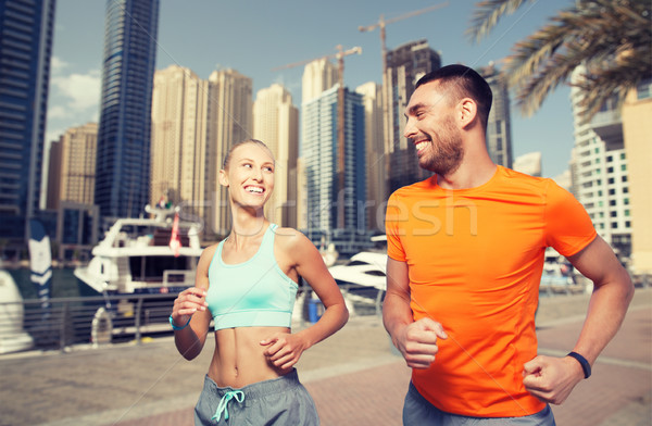 Couple courir Dubaï rue de la ville fitness sport Photo stock © dolgachov