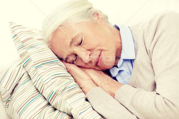Szczęśliwy starszy kobieta snem poduszkę domu Zdjęcia stock © dolgachov