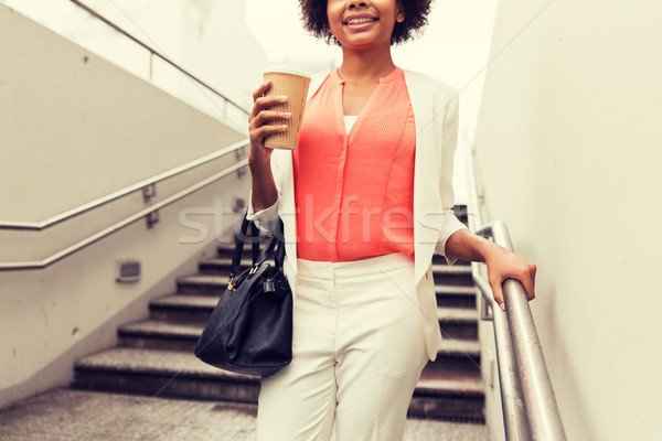 close up of african businesswoman with coffee Stock photo © dolgachov