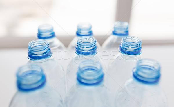 Boş kullanılmış plastik şişeler tablo Stok fotoğraf © dolgachov