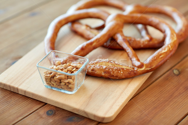 close up of peanuts and pretzels on wooden table Stock photo © dolgachov