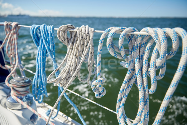 close up of mooring rope on sailboat or yacht Stock photo © dolgachov
