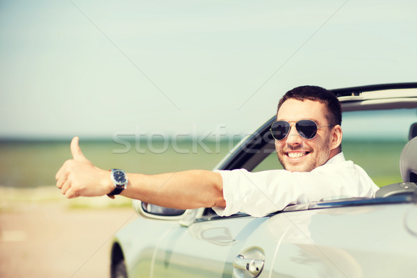 happy man driving car and showing thumbs up Stock photo © dolgachov