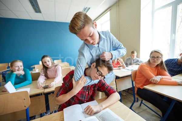étudiant garçon souffrance compagne éducation Photo stock © dolgachov