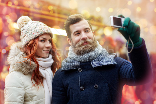 couple taking selfie with smartphone in old town Stock photo © dolgachov